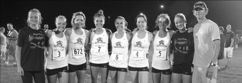 Sheri Brown Augustana women Kristin Brondbo, Megan Brown, Gabi Swoboda, Kaitlyn Yoerg, Cassidy Soli, Meritxell Delgado, Runa Falch and Emma Anderson stand with Cross Country Headcoach Tracy Hellman after the team took second place at Augie's Twilight meet, Sept. 6.  Photo by Sheri Brown