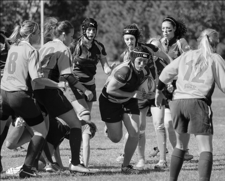 Junior Meagan O'Connell, president of the Augustana rugby club, charges downfield for the Vikings.