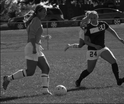Senior Maren Werth takes the ball down Morstad Field against Bemidji State last Saturday to help the Vikings win, 2-1.