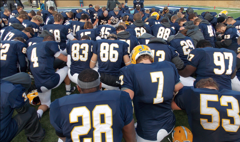 Augustana's football team prays before their last game against Southwest Minnesota State last Saturday, Nov. 16.